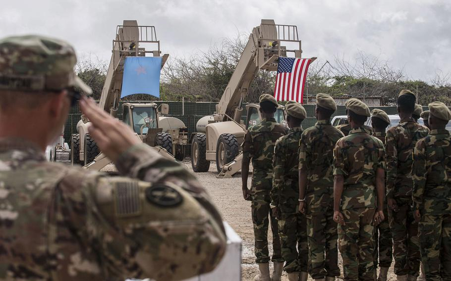 In an August, 2018 photo, Somali national army soldiers stand in formation during a logistics course graduation ceremony.  Soldiers from Somalia's advanced infantry DANAB battalion spent 14 weeks training with the U.S. 10th Mountain division on the importance of logistical operation as well as the operation and maintenance of heavy equipment.