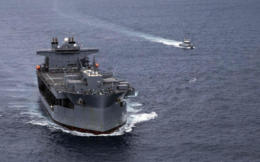 The Expeditionary Sea Base USS Hershel ''Woody'' Williams  conducts a passing exercise with a Senegalese navy patrol vessel in the Atlantic Ocean off the west coast of Africa in September 2020. The ship is now off the east African coast in an operation to remove U.S. forces from Somalia.
