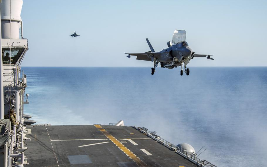 U.S. Marine Corps F-35B Lightning IIs with the15th Marine Expeditionary Unit prepare to land on the flight deck of the amphibious assault ship USS Makin Island in the Indian Ocean, Dec. 18, 2020.