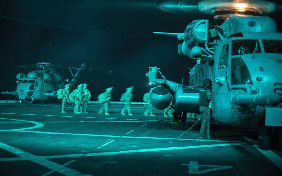 U.S. Marines and sailors with the 15th Marine Expeditionary Unit board a CH-53E Super Stallion during a quick reaction force drill aboard the USS San Diego,  in support of Operation Octave Quartz in the Indian Ocean off the coast of Somalia, Dec. 20, 2020.