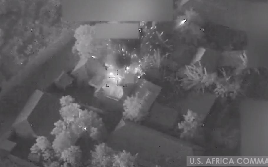 A screenshot from a video shot by U.S. Africa Command shows airstrikes on an al-Shabab compound near the town of Qunyo Barrow in Somalia on Jan. 1, 2021. Three al-Shabab militants were killed in the strikes and six buildings were destroyed, AFRICOM said in a statement.