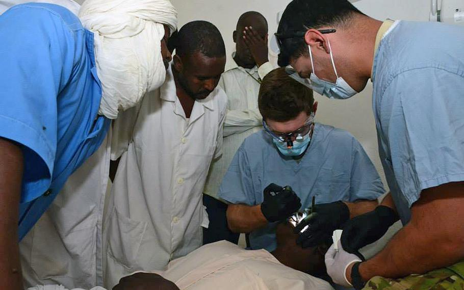 U.S. Army Capt. Ross Cook, a dentist, and Sgt. Luis Hernandez, a dental technician, 10th Special Forces Group (Airborne), instruct nurses how to perform a tooth extraction in Faya, Chad, Feb. 19, 2015. Ross and Hernandez are in Chad as part of the Flintlock 2015 exercise, an annual, African-led military exercise focused on security, counterterrorism and military humanitarian support to outlying areas.