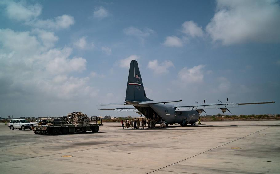 A U.S. Air Force C-130 sits on the tarmac as U.S. airmen deploy to Mozambique to deliver relief supplies into areas where floods have forced thousands from their homes.
