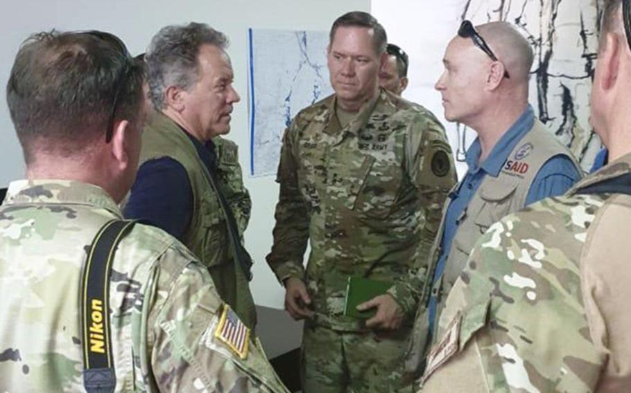 U.S. Army Maj. Gen. James D. Craig, center, Combined Joint Task Force Horn of Africa commander, talks with staff from the U.S. Agency for International Development about getting aid to people affected by Cyclone Idai in Mozambique.