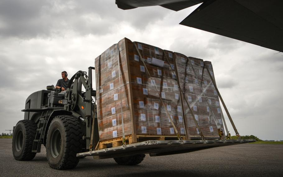 Air Force Master Sgt. Patrick Wagnon, assigned to Combined Joint Task Force-Horn of Africa, unloads a World Food Program pallet from a C-130J Hercules at Maputo International Airport, Mozambique, March 30, 2019, for the relief effort in Mozambique and surrounding areas following Cyclone Idai.