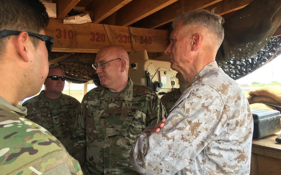Marine Gen. Thomas D. Waldhauser, commander of U.S. Africa Command, and Brig. Gen. Michael D. Turello, incoming commander of the Combined Joint Task Force-Horn of Africa, get an operations update at an undisclosed forward operating location in Somalia on Tuesday, June 11, 2019.