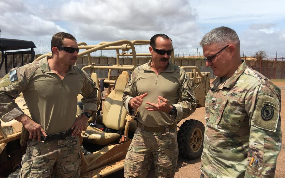 Col. Charles Bergman, lead integrator for U.S. Africa Command operations in Africa, receives a brief from U.S. personnel at a forward operating location in Somalia on Tuesday, June 11, 2019.