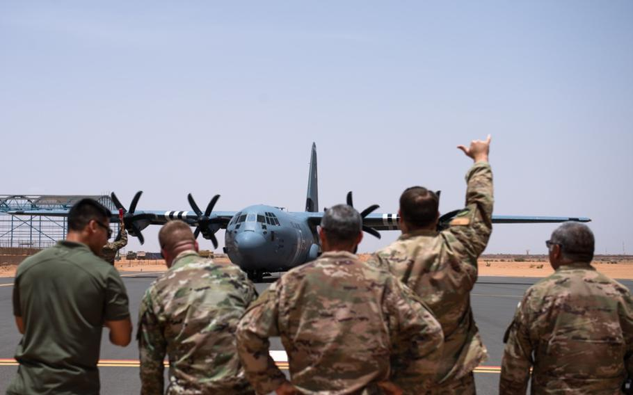 Airmen assigned to the 409th Air Expeditionary Group watch as a C-130J Super Hercules taxis in at Nigerien Air Base 201, Agadez, Niger, Aug. 3, 2019. The C-130 landing marked the next step in airfield evaluations at the base.