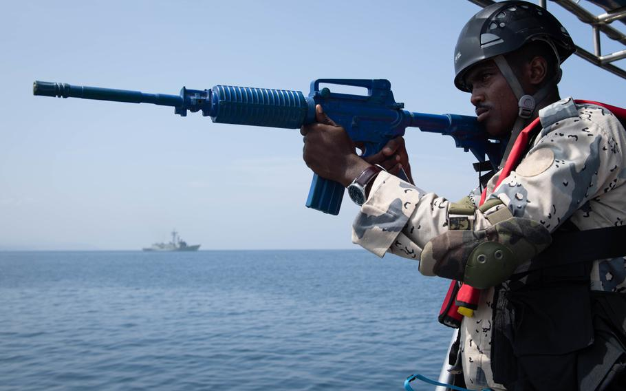 A Djiboutian coast guardsman participates in a visit, board, search and seizure exercise during Cutlass Express and the International Maritime Exercise off the coast of Djibouti, Africa, Nov. 3, 2019.
