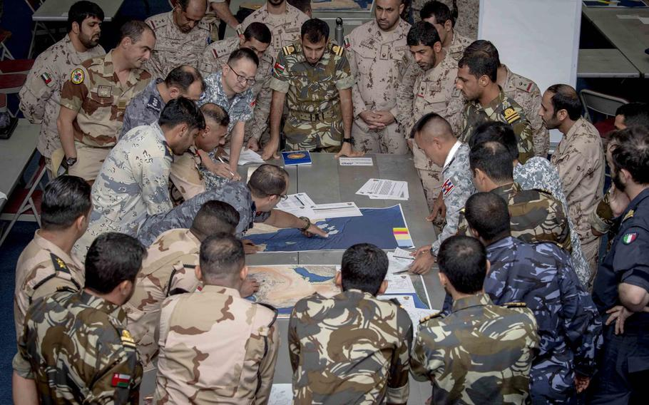 Military personnel from several nations plan a simulated joint operation off the southern coast of Oman as part of International Maritime Exercise, at Naval Support Activity, Bahrain on October 24, 2019. The exercise will continue through mid-November.