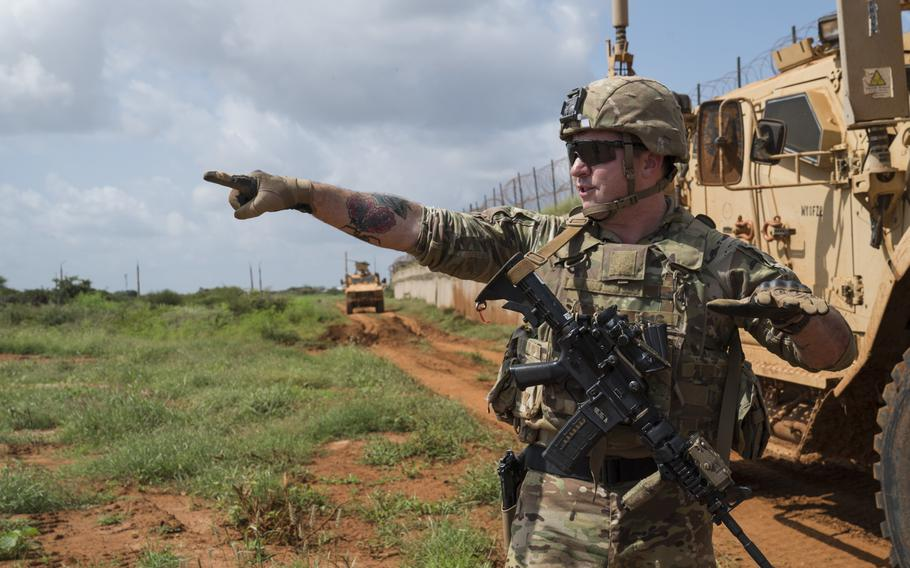 U.S. Army Sgt. Don Baldwin, 1-186th Infantry Battalion, Oregon National Guard, points to the horizon while explaining items of interest to look out for during a security patrol in Somalia, on December 3, 2019.