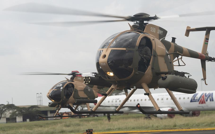 Two MD-530F Cayuse Warrior helicopters prepare to take off during a handover ceremony at Embakasi Barracks, Kenya, Jan. 23, 2020. Six of the helicopters were delivered to the Kenya Defense Force and six more are expected in the near future.
