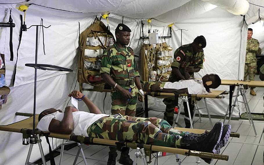 Senegalese soldiers learn how to set up, take down and operate the mobile hospital at the Senegal Rapid Deployment Capabilities Center in Touba, Senegal. One of these hospitals is being used by medical staff to respond to the coronavirus outbreak.
