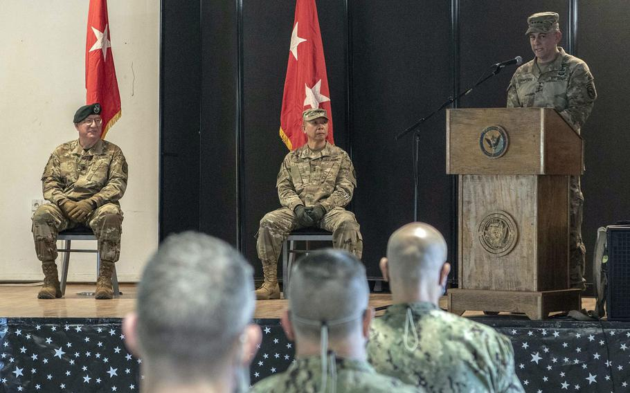 U.S. Army Gen. Stephen J. Townsend, right, commander of U.S. Africa Command, presides over the socially distanced change-of-command ceremony for Combined Joint Task Force-Horn of Africa, June 8, 2020, at Camp Lemonnier, Djibouti. Maj. Gen. Lapthe C. Flora, center, took command from Maj. Gen. Michael D. Turello.