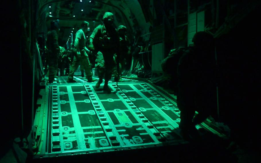 U.S. Army soldiers assigned to the East Africa Response Force, 101st Airborne Division, exit a C-130J Super Hercules assigned to the 75th Expeditionary Airlift Squadron at Manda Bay Airfield, Kenya, on January 5, 2020. The U.S. wants permission to strike terrorists in Kenya following a pre-dawn attack that day by al-Shabab militants, in which three Americans were killed.
