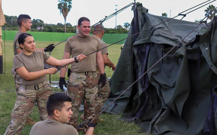 Members of the Puerto Rico National Guard's 105th Quartermaster Company of the 3678th Combat Sustainment Support Battalion erect tents Wednesday, Jan. 7, 2020, following a 6.4-magnitude earthquake that shook the southern half of the island Tuesday.