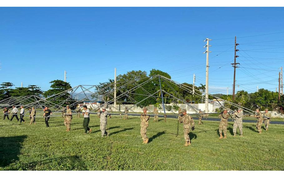 Puerto Rico National Guard members on Jan. 11, 2020, build a tent to shelter people in Guanica following a series of devastating earthquakes in the southern region of the island. About 650 service members were activated to help with five camps in cities most heavily impacted by earthquakes.