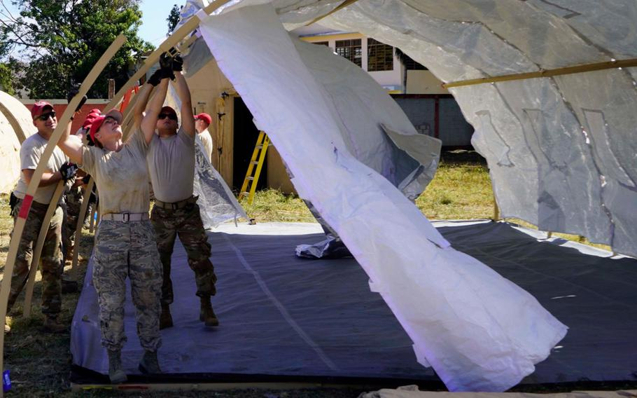 Members of the Ohio Air National Guard set up a disaster relief bed-down set in Guayanilla, Puerto Rico, on Jan. 19. Troops are assisting the Puerto Rico Housing Department with logistics and support for clean beds, necessary supplies, power, shower and laundry capabilities and limited medical care for displaced citizens in five base camps established in municipalities across southern Puerto Rico following the 6.4-magnitude earthquake near the coast of Guanica.