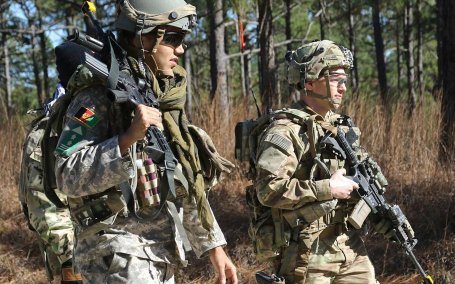 In a January, 2018 photo, Capt. Justin M. Alexander, a combat advisor team leader for 1st Battalion, 1st Security Force Assistance Brigade, walks with an Afghan National Defense Security Forces role player during a simulated event at the Joint Readiness Training Center in Fort Polk, La.