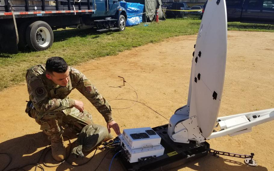 Air Force Staff Sgt. Kelvin Matos with the 156th Communications Flight powers up the SATCOM Hawkeye II satellite dish to provide voice, data, network and commercial internet capabilities at the Guanica tent city to support Task Force South and the displaced citizens affected by the earthquakes that shook the island in early January 2020.