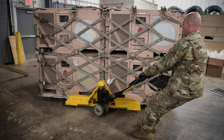 Airmen of the Ohio Air National Guard -- 179th Airlift Wing and 200th Red Horse Squadron -- prepare disaster relief bed-down sets Jan. 12, 2020 in response to Puerto Rico earthquake relief efforts.