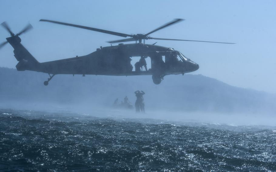 Members of the Army's 7th Special Forces Group practice helocasting from a Black Hawk helicopter with Salvadoran Special Forces soldiers at Lake Ilopango, El Salvador, March 7, 2019.