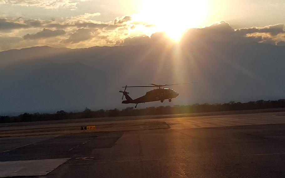 A medical helicopter with the 228th Aviation Regiment lands as the sun sets behind the mountains overlooking Soto Cano Air Base, Honduras, March 7, 2019.