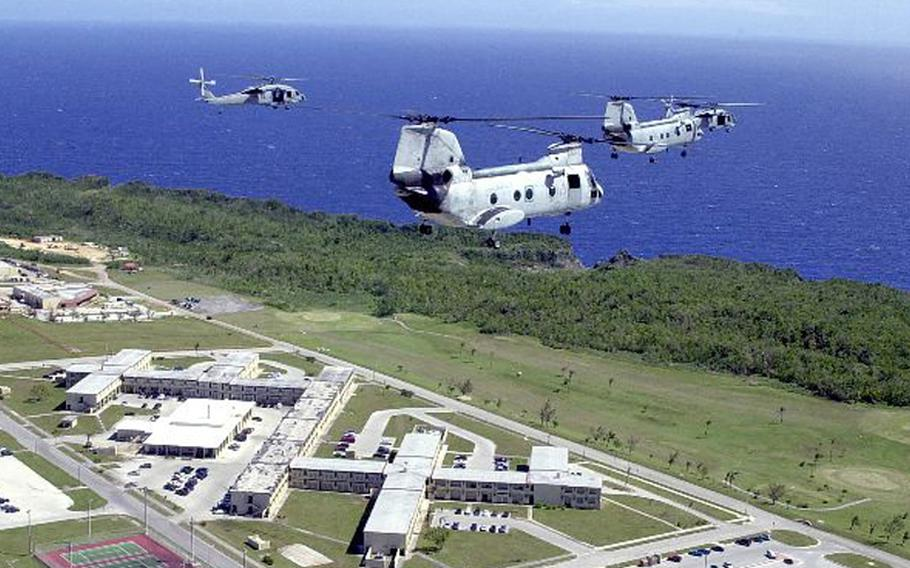 Two UH-46 Sea Knights and two MH-60 Knight Hawks fly over Andersen Air Force Base, Guam, in this file photo.