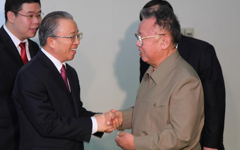 North Korean leader Kim Jong Il, right, shakes hands with Chinese State Councilor Dai Bingguo during a meeting Thursday in Pyongyang, North Korea. Although the U.S. has been pressuring China to hold talks with North Korea following a recent attack on a South Korean island, analysts say the meeting should not be viewed as China caving to those demands.