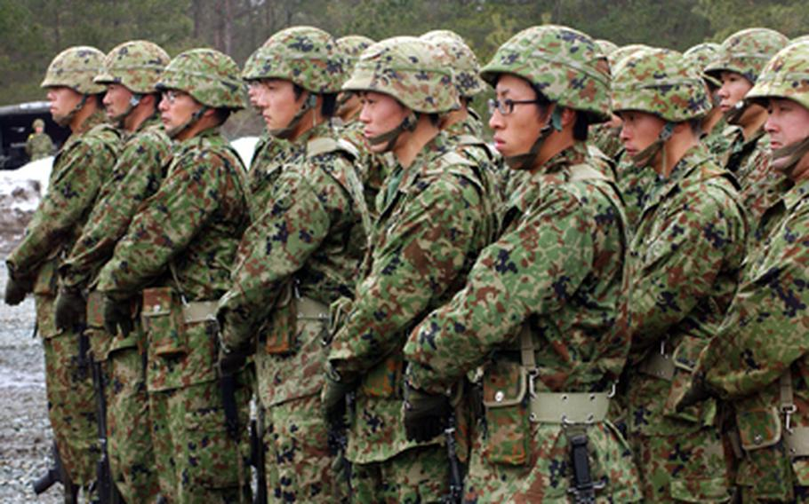 Members of Japan's Self-Defense Force stand in formation.