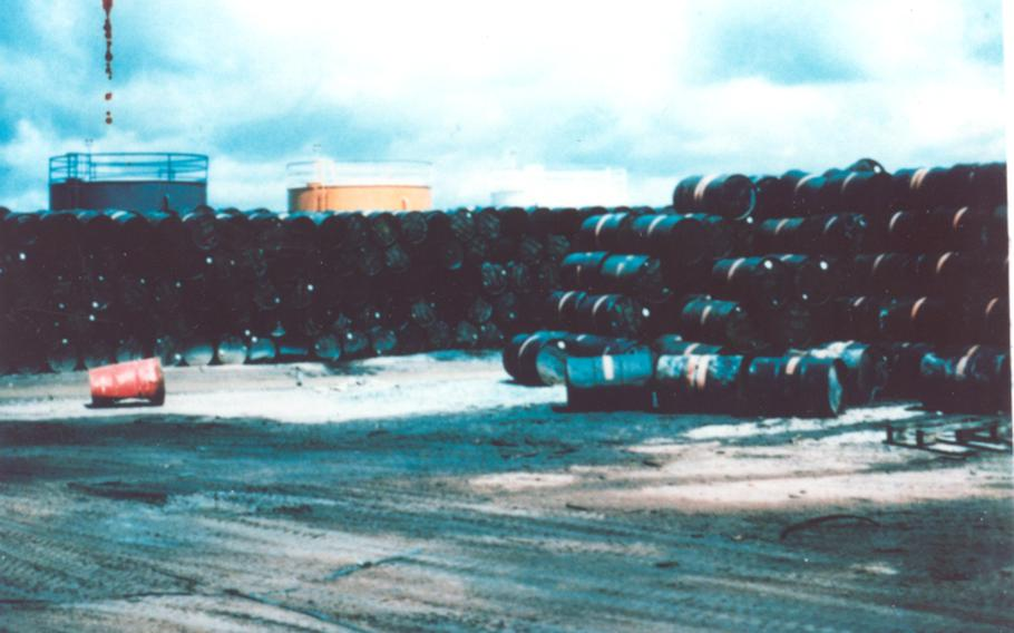 Large stacks of 55-gallon drums filled with Agent Orange.