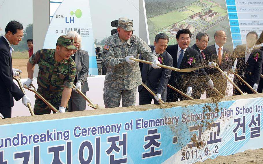 U.S. Forces Korea commander Gen. James Thurman shovels dirt Sept. 2, 2011, at a groundbreaking ceremony in Pyeongtaek for an elementary school and high school that will eventually serve the U.S. Army Garrison-Humphreys community.
