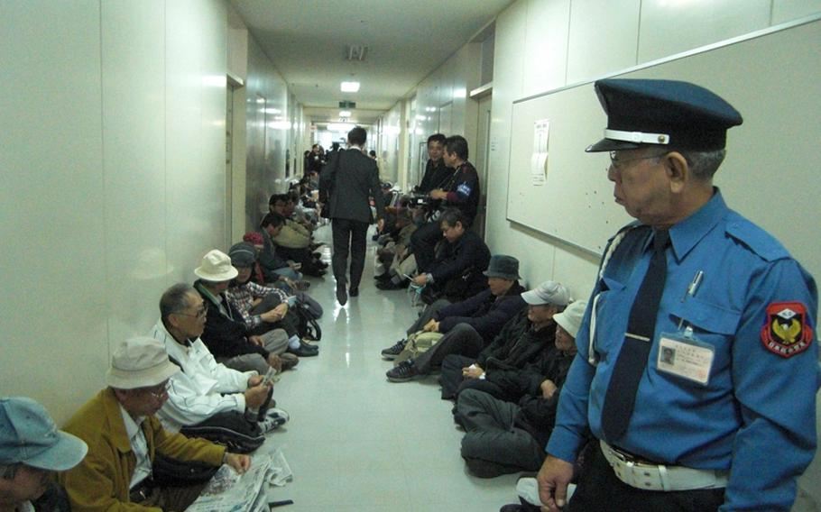 Protesters stag sit-in Dec. 28, 2011, after learning that the Japanese Ministry of Defense had clandestinely delivered a controversial environmental assessment report for a new Marine Corps air facility planned on Camp Schwab to the prefectural government office early in the morning before business hours.