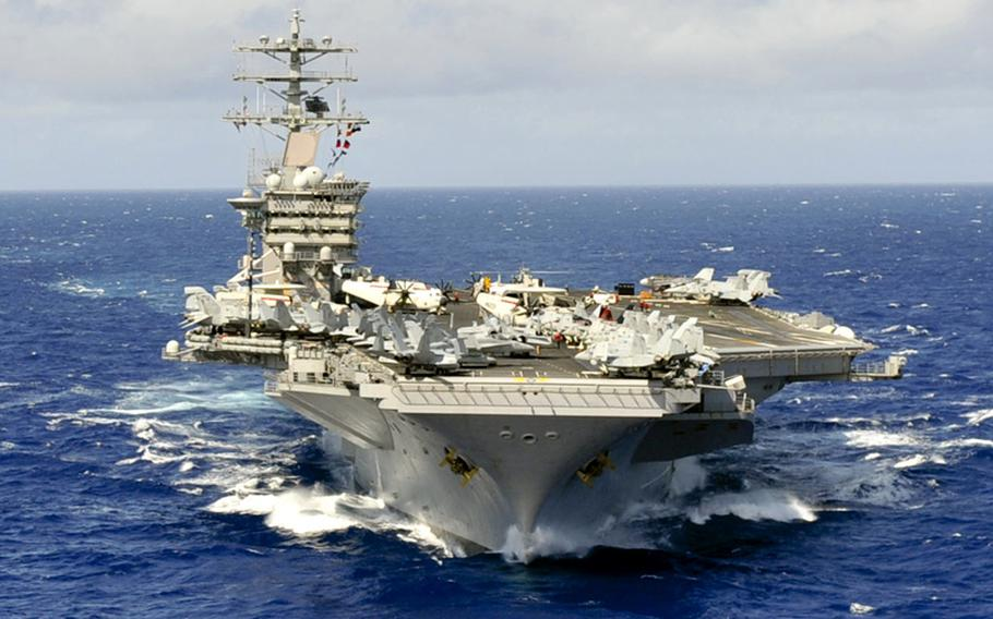 The aircraft carrier USS Nimitz participates in the Great Green Fleet Demonstration as part of Rim of the Pacific 2012.