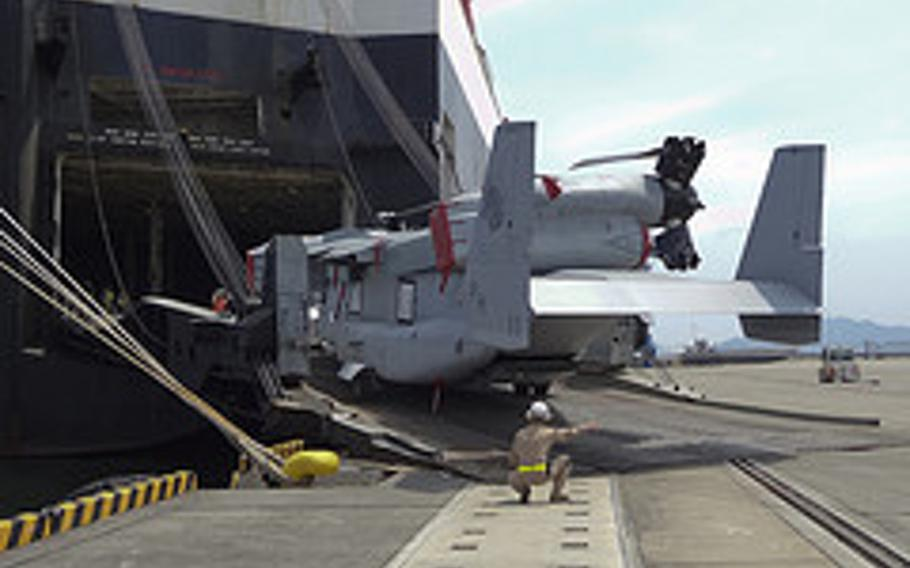 An MV-22 Osprey aircraft with Marine Medium Helicopter Squadron 265 is unloaded from the cargo ship Green Ridge at the Marine Corps Air Station Iwakuni harbor July 23, 2012. This marks the first MV-22 Osprey aircraft deployment to Japan and a milestone in the Marine Corps' process of replacing CH-46E helicopters with the MV-22 Osprey.