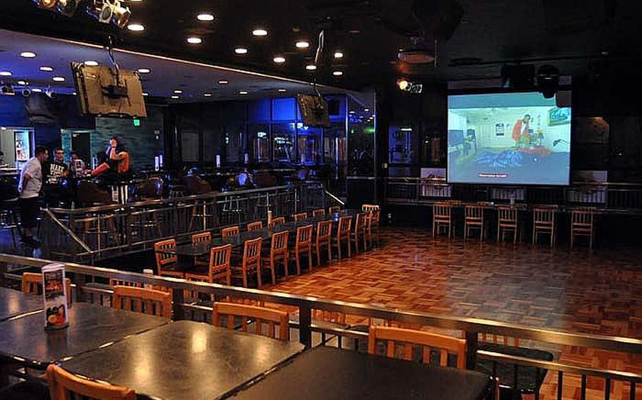 Club Alliance on Yokosuka Naval Base, Japan, is all but empty minutes before curfew on Oct. 22, 2012.