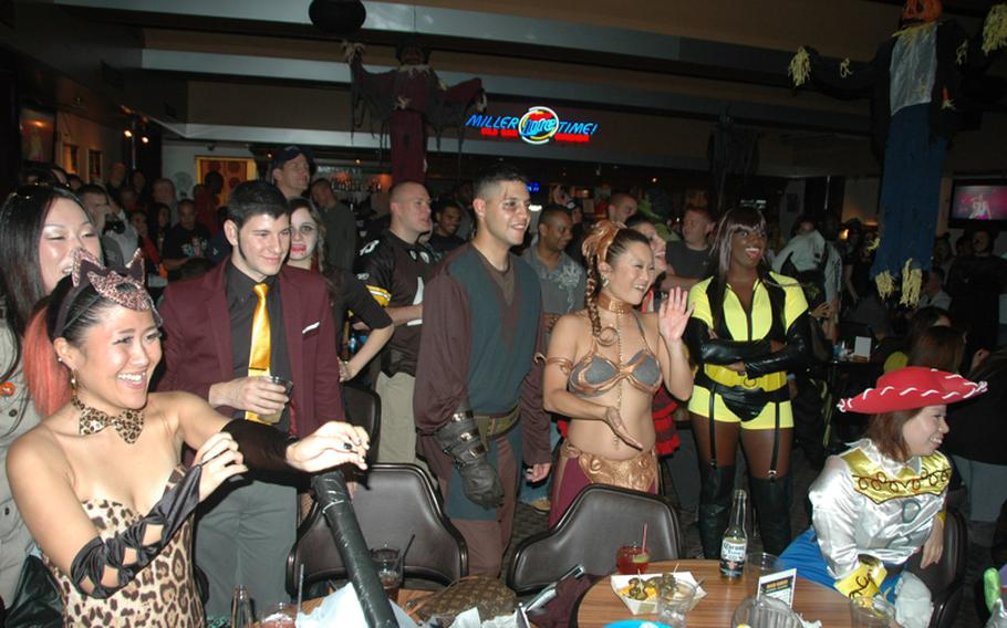 The Yokota Enlisted Club was packed with servicemembers and local nationals celebrating Halloween during the weekend Oct. 26 and 27, 2012.