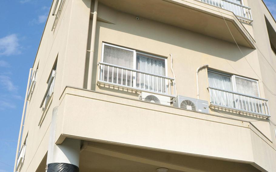 A 24-year-old U.S. airman is accused of punching a young boy in this apartment in Chatan, Okinawa, then falling out a window while trying to escape.
