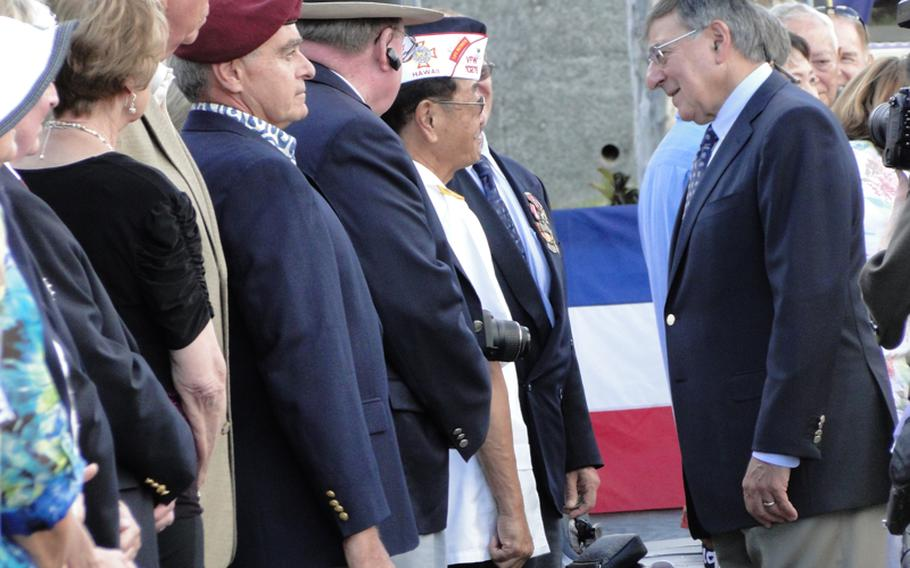 Defense Secretary Leon Panetta speaks with veterans Nov. 11, 2011, at the National Memorial Cemetery of the Pacific in Honolulu, Hawaii, before embarking on a trip to Asian nations.