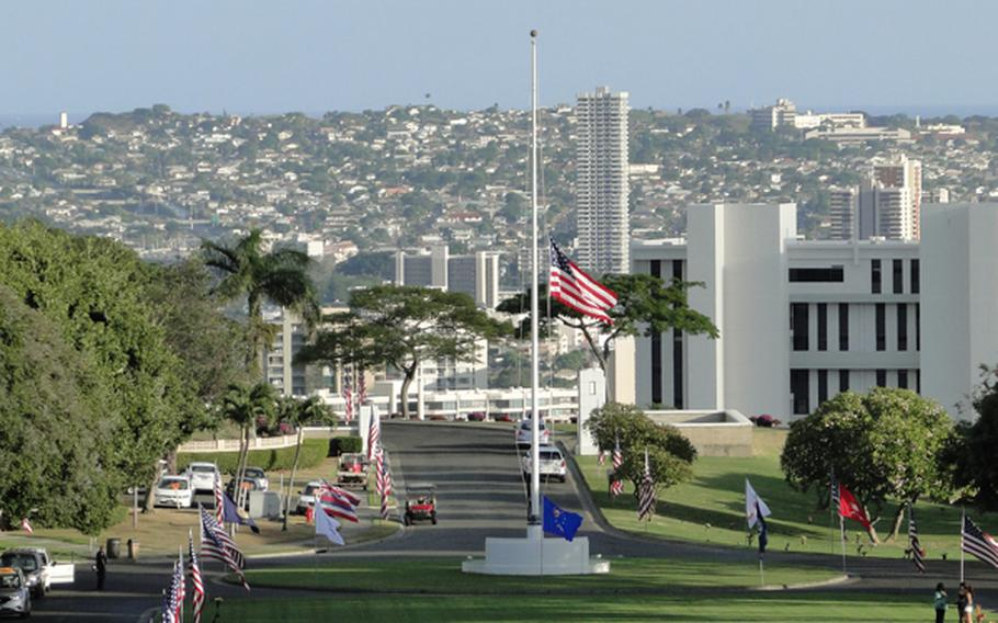 The U.S. flag flies at half staff at the National Memorial Cemetery of the Pacific, which overlooks Honolulu, on Veterans Day, Nov. 11, 2012.