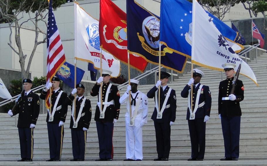 An honor guard takes its position at the National Memorial Cemetery of the Pacific in Hawaii on Veterans Day, Nov. 11, 2012.