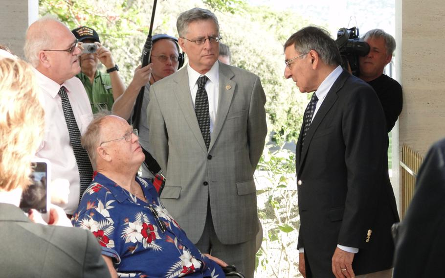 Defense Secretary Leon Panetta, right, speaks with former Sen. Max Cleland, a Vietnam veteran, at a Veterans Day ceremony Nov. 11, 2012, at the National Memorial Cemetery of the Pacific in Hawaii.