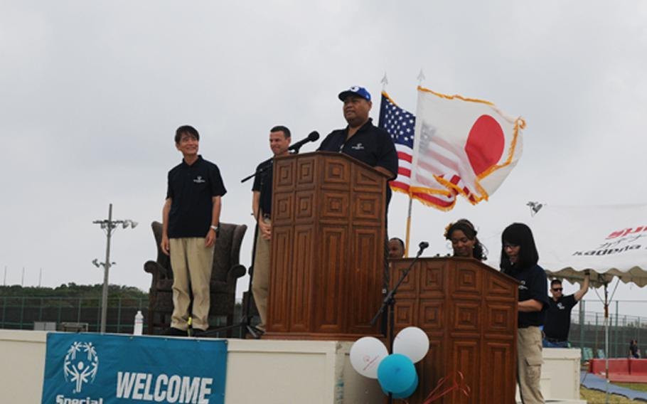 The former sumo wrestler, Konishiki, announces the opening of the 13th Kadena Special Olympics at Kadena Air Base Saturday.  The Hawaii-born retired sumo wrestler visits Kadena Air Base to cheer the event for special-needs athletes from both Okinawa and U.S. military communities on the island.  About 900 athletes compete in the games while about 3,000 American and Japanese volunteers gather to cheer the athletes and support the annual event.