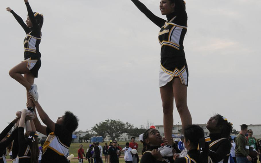 Kadena Panthers cheerleading squad perform at the opening ceremony of the Kadena Special Olympic Saturday.  The annual sports event for special -needs athletes has been supported by goodwill volunteers. On Saturday, nearly 3,000 servicemembers, civilians and their families in U.S. military communities on the island, as well as Japanese volunteers, join the event to support about 900 athletes to compete in various games, such as 30-meters dash, wheelchair softball throw, floor hockey, frisbee toss and basketball throw.