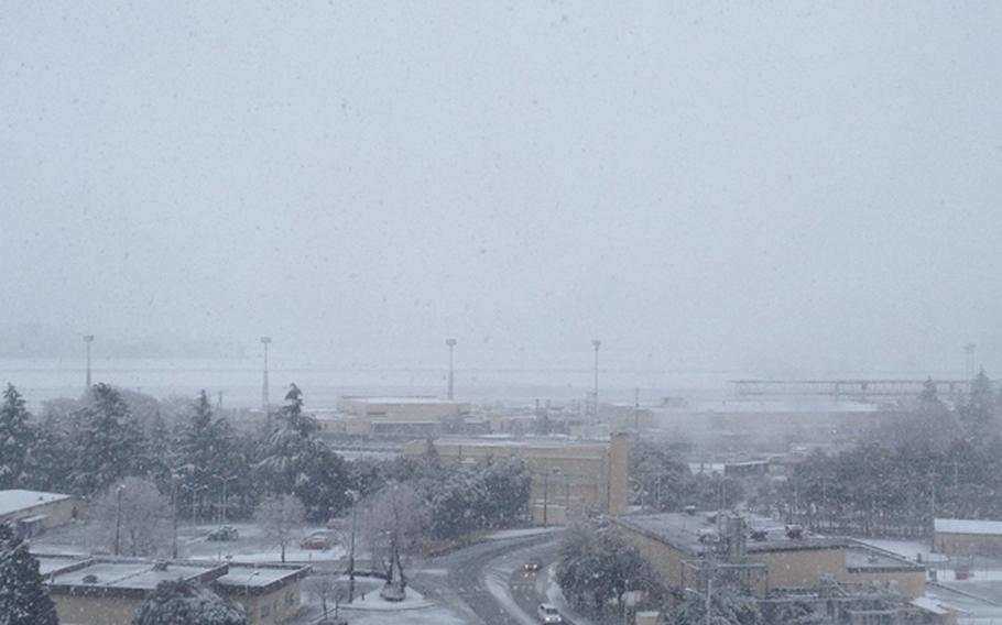 Snowfall obscures the runway in the distance at Yokota Air Base in western Tokyo, Jan. 14, 2013.