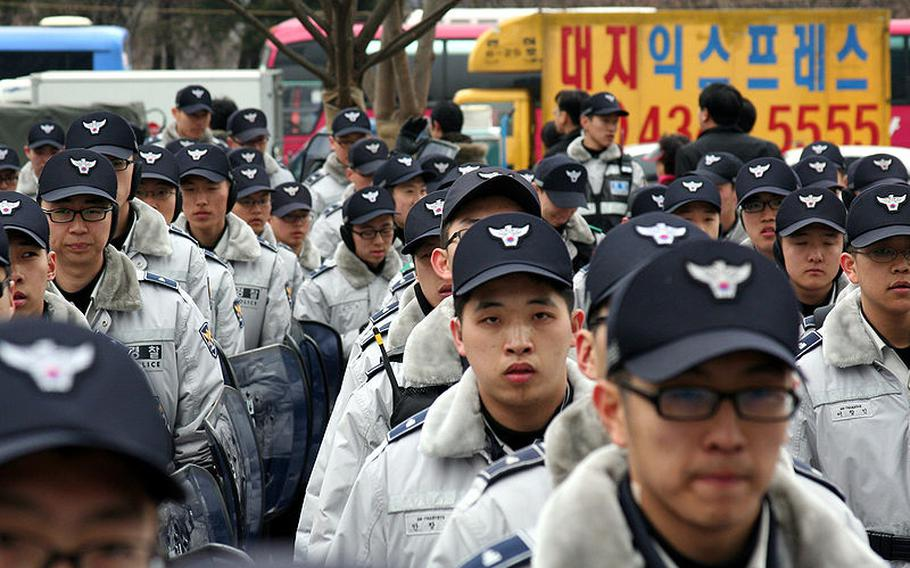 Officers with the National Police Agency in South Korea assemble for duty in Seoul, Feb. 25, 2008.