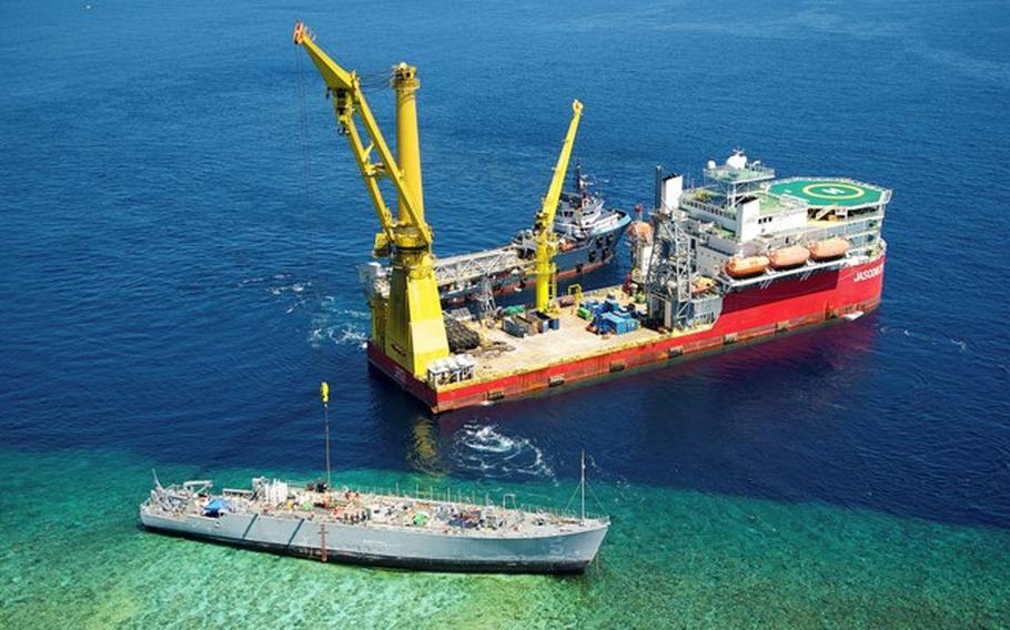 Aerial shot shows contracted vessels working on the dismantling of the USS Guardian off the Tubbataha Reef in the Sulu Sea, off the coast of the Philippines, March 12, 2013.
