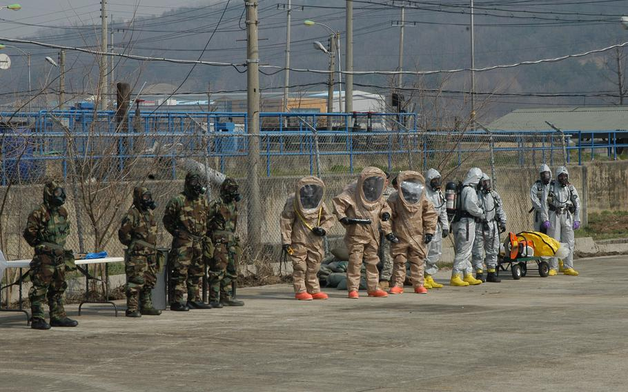 Members of the 23rd Chemical Battalion don protective gear to participate in a demonstration on April 4, 2013, at Camp Stanley in South Korea.