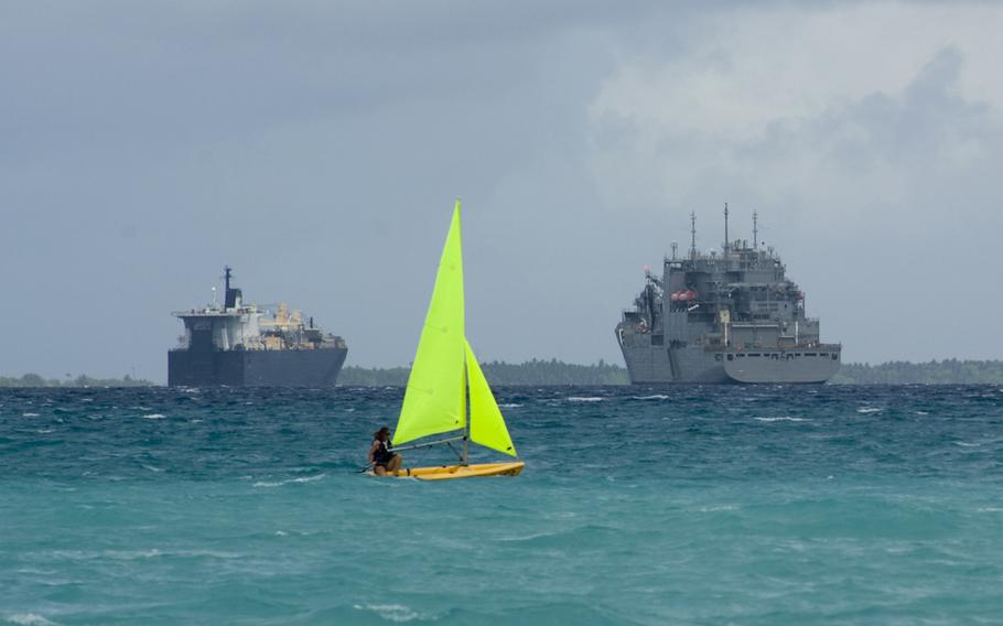 A sailor assigned to U.S. Naval Support Facility Diego Garcia relaxes on a Sunday afternoon by sailing on a Pico sailboat near the Morale, Welfare and Recreation Marina in this Nov. 2012 photo.