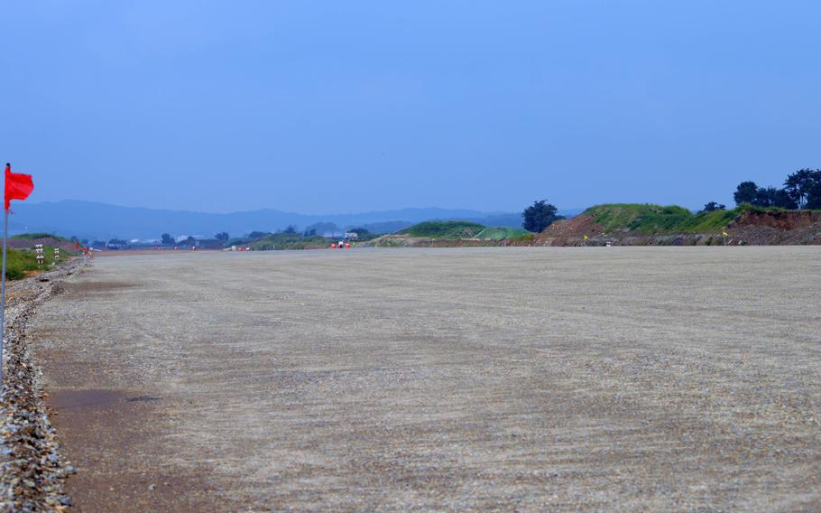 A portion of smoothed and graded area for the new runway for Osan Air Base, South Korea, Aug. 30, 2013. The construction will allow for a second parallel runway.